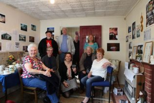 Elisabeth and Jane with prefab residents and enthusiasts. The Prefab Museum | Prefab Museum