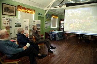 Visitors at the Rural Life Centre, July 2016, viewing a film about prefabs | Prefab Museum