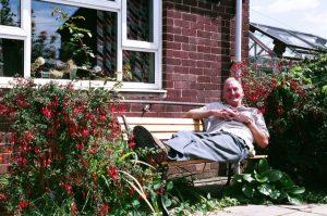 Graham in his neighbour Margaret's prefab garden, North Wingfield, August 2005