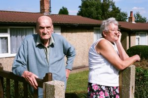 Jean and her husband Ronald in front of their prefab, Chesterfield, August 2005