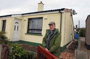Callum Macleod in front of his prefab, Plasterfield, Stornoway, Lewis, Scotland, October 2012