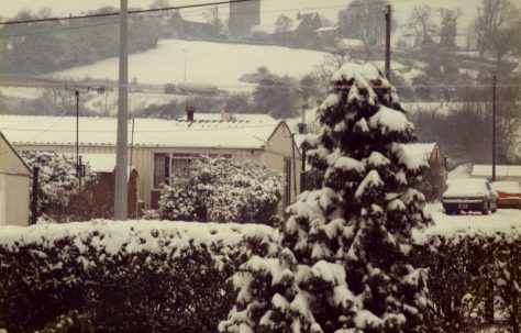 A prefab (Arcon Mk V) covered with snow, and tree, Newport, Wales