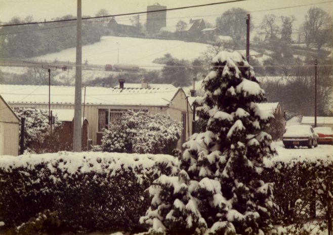 A prefab (Arcon Mk V) covered with snow, and tree, Newport, Wales | Blanchet,Elisabeth