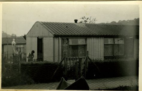 An Arcon Mk V with man in garden on the Bishpool Estate, Newport, Wales, 50s