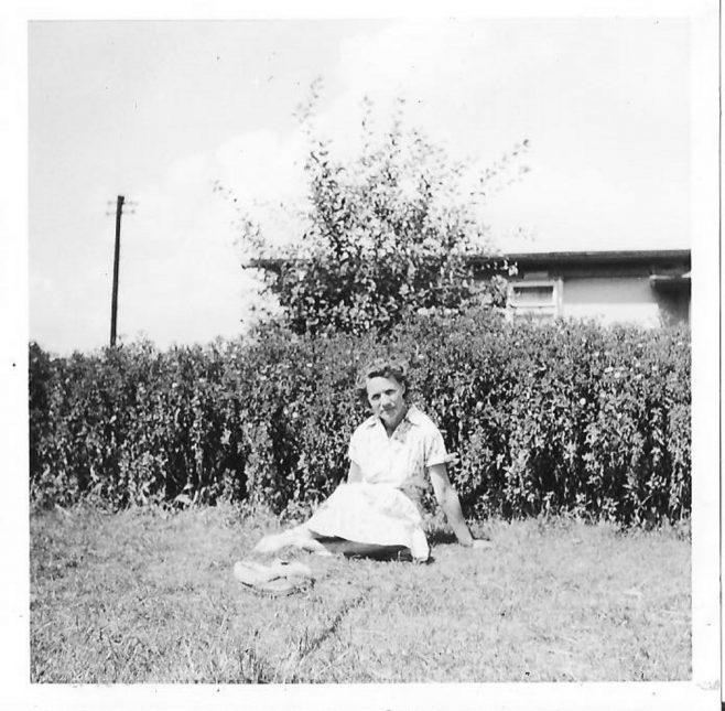Mrs Clare sitting in the garden of her prefab | Hearn,Jane