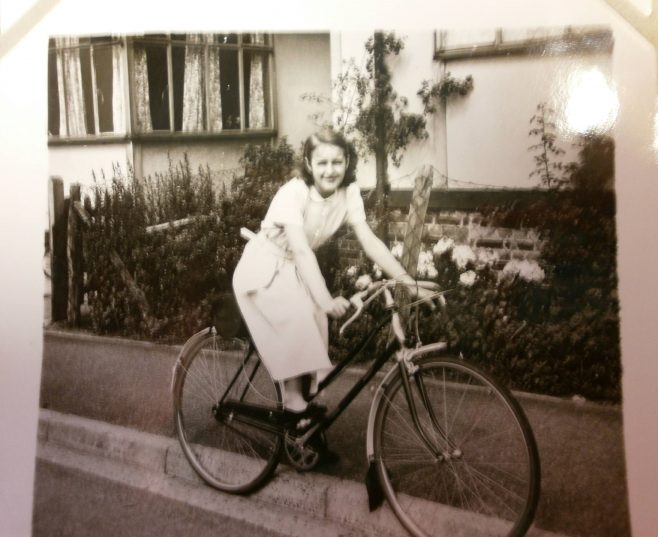 Girl on bicycle in front of prefab | Hearn,Jane