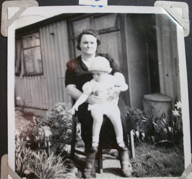 Woman with baby in front of Arcon prefab | Hearn,Jane