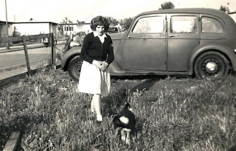Rosemary Brine in the prefab garden with dog and car in the background
