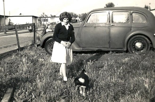 Woman, possibly of the Brine family in a prefab garden with car | Blanchet,Elisabeth
