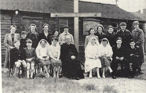 "The Brine family outside St Mark's Church, before it was rebuilt as the ""Prefab Church"""