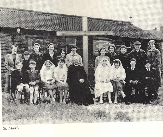 The Brine family outside St Mark's Church, before it was rebuilt as the