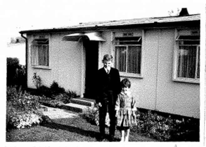 Photo of Allen and Judith Sawkins' family prefab (AIROH) in Farnham, Surrey, 50s, with brother and sister Allen and Judith in front of prefab | Blanchet,Elisabeth