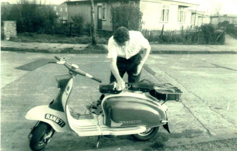 Bob Strudwick working on his scooter, taken from Mr and Mrs Marshalls prefab at No 6, Strattondale Street, Isle of Dogs, London 50s or 60s
