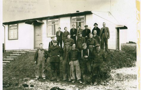 John Mason with other men in front of an AIROH Prefab  on the Wilson Avenue site, Whitehawk, Brighton in 1946.