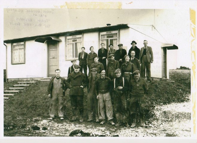 John Mason with other men in front of an AIROH Prefab  on the Wilson Avenue site, Whitehawk, Brighton in 1946. | Blanchet,Elisabeth
