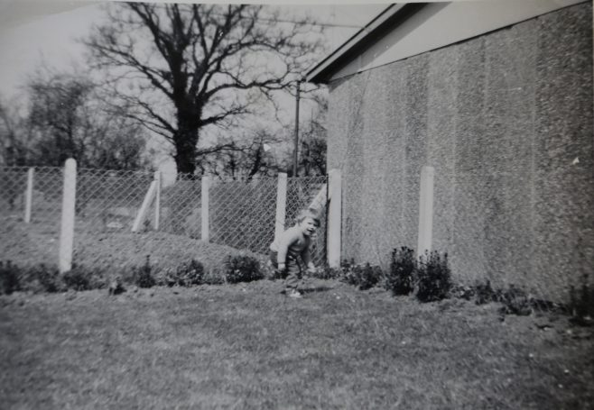 One of the Kapitan children playing in the prefab garden | Hearn,Jane