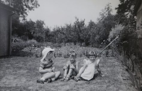 Three small children in the Kapitan prefab garden in Ipswich