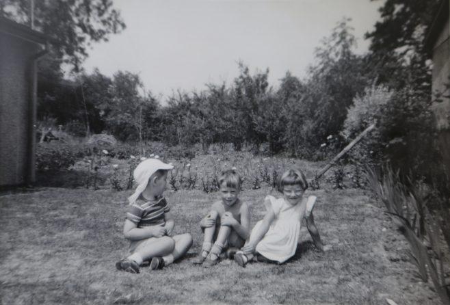 Three small children in the Kapitan prefab garden in Ipswich | Hearn,Jane