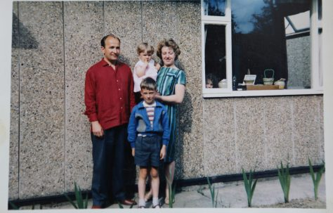Mrs and Mrs Kapitan with their two children in front of their Ipswich prefab