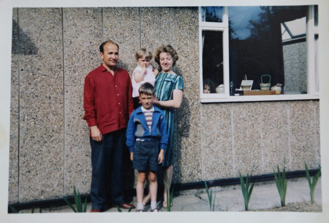 Mrs and Mrs Kapitan with their two children in front of their Ipswich prefab | June Kapitan