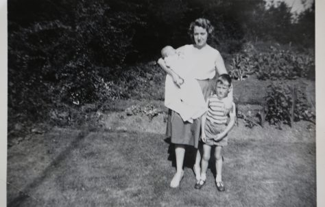 June Kapitan and her two children outside their prefab in Ipswich
