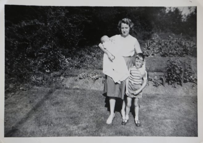 June Kapitan and her two children outside their prefab in Ipswich | Hearn,Jane