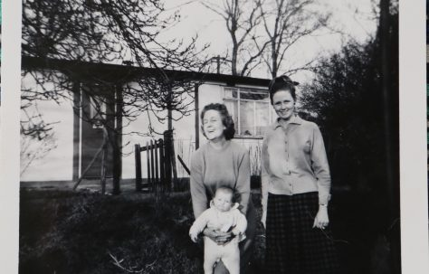 Penny Bishop and family outside their prefab in Willesden