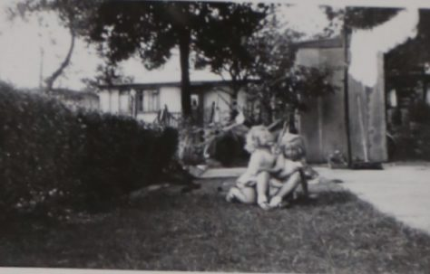 Two small children in the prefab garden in Willesden