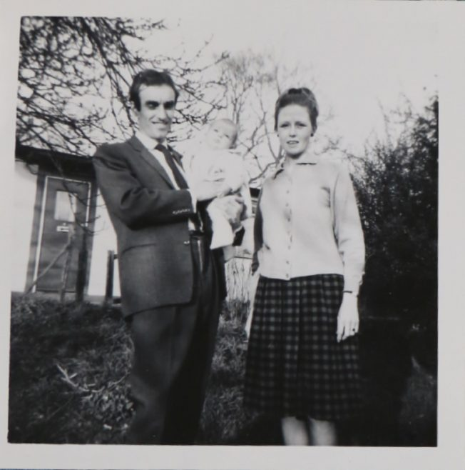 Penny Bishop as a baby with her mum and dad outside their prefab | Hearn, Jane