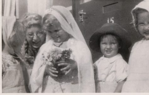 Kathryn, her brother Neal and three children in fancy dress outside the prefab, St Pauls Cray