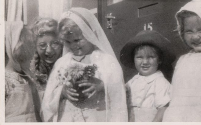 Kathryn, her brother Neal and three children in fancy dress outside the prefab, St Pauls Cray | Hearn, Jane