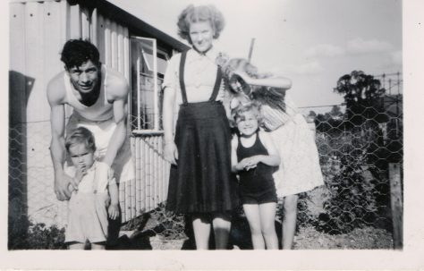 Kathryn, her brother Neal and mum and dad outside their prefab, St Pauls Cray