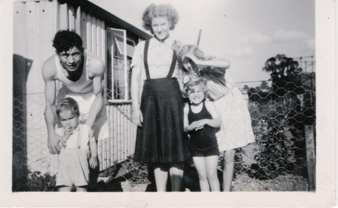 Kathryn, her brother Neal and mum and dad outside their prefab | Hearn, Jane
