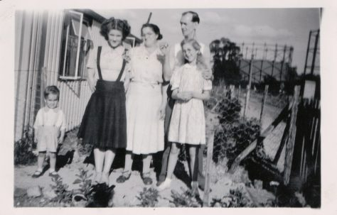 Family group outside the prefabs, Robin Way, St Pauls Cray