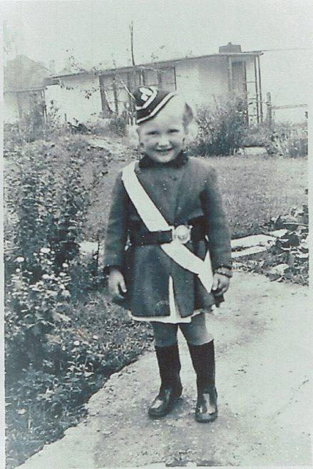 Small child in costume in prefab garden   Hearn, Jane