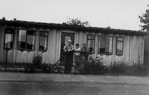 Peter Gale's family in front of their prefab, the second they were allocated in Portsmouth