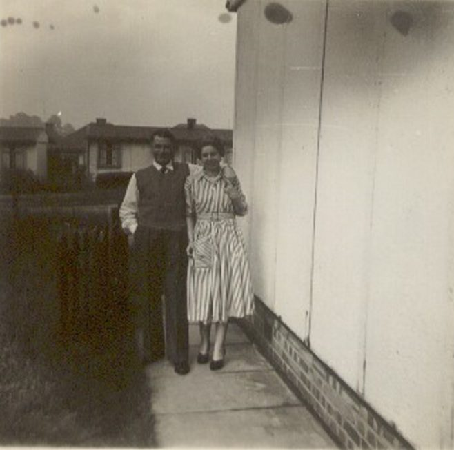 Melanie's parents outside their prefab at Lowden Croft, South Yardley, Birmingham