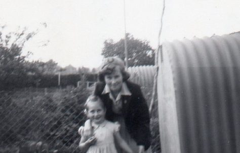 Judy Hewins and her sister in their prefab garden
