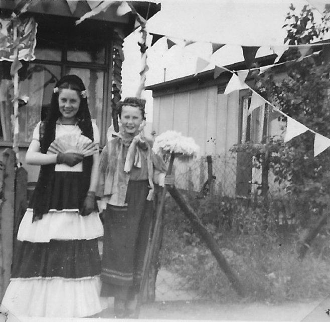 Two children in fancy dress, 'Mrs Mop'.  Stewart Street, London E14