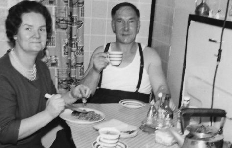 Mum and Dad in the prefab kitchen.  Stewart Street, London E14