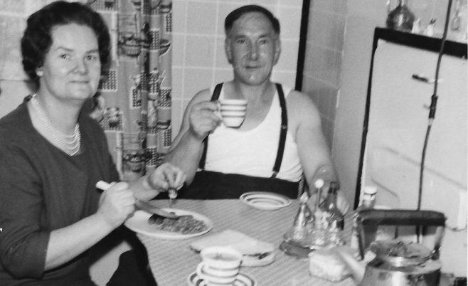 Mum and Dad in the prefab kitchen.  Stewart Street, London E14 | George Warren