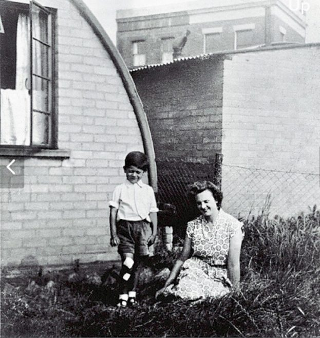 Peter and his mother in front of their Nissen Hut in Bentham Road, London E9