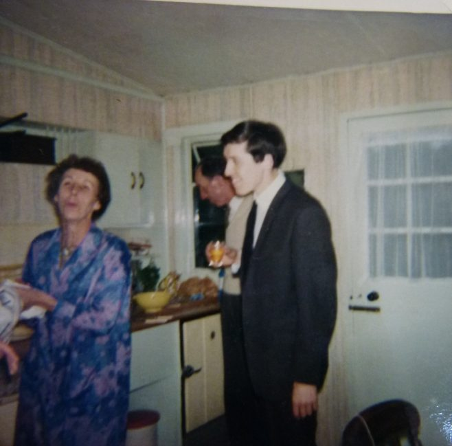 Woman and man in prefab kitchen, 401 Wake Green Road, Moseley