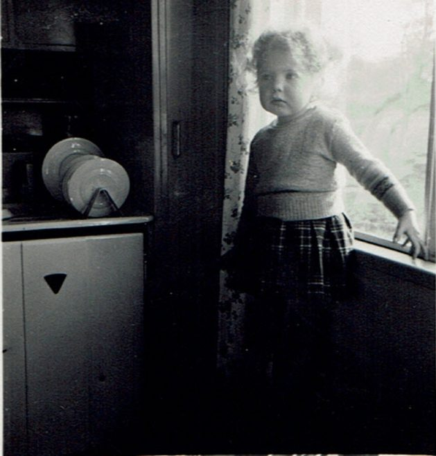 Suzanne aged two and a half years in the family prefab at Brake Road, Crown Hill