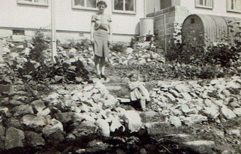 Suzanne and her mother in the back garden of their prefab at Brake Road, Crown Hill