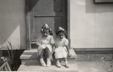 Two little girls sitting on a prefab step on the Harold Hill estate