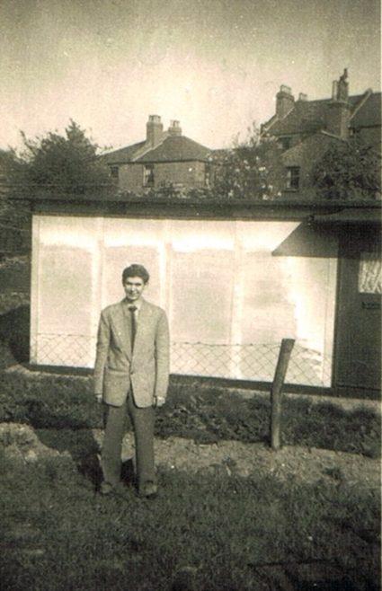 Brother Len in garden of 74 Narford Road. Next door's prefab can be seen