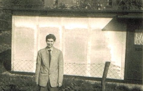 Brother Len in garden of 74 Narford Road. Next door's prefab can be seen