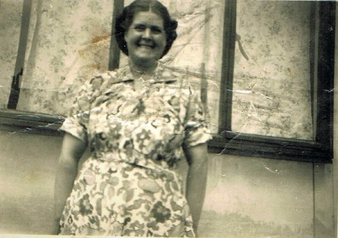Mum outside the prefab looking happy. Narford Road, London E5