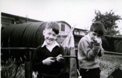 John and friend in prefab garden, Underhill Road, London SE22